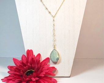 Gold filled Y necklace. Aquamarine stone and crystals