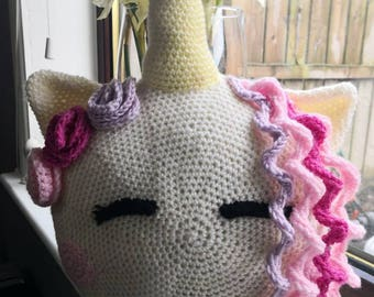 A Handmade crochet Unicorn Cushion