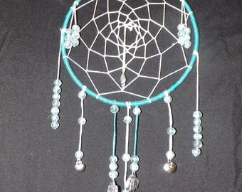 dreaming of the sea dream catcher with charms instead of feathers. Great for a beach house or a beach lover.