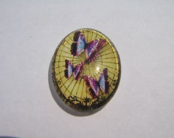 Glass cabochon oval 25 X 18 mm with a purple butterfly image
