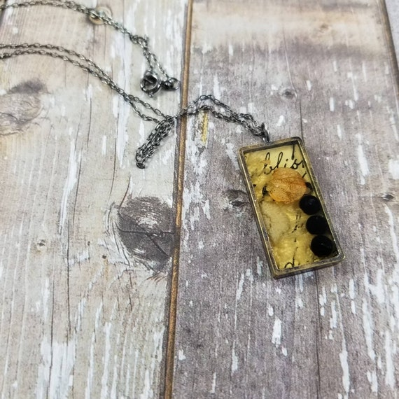 Mixed Media Collaged Resin Necklace No. 1, Faceted Garnets, Vintage Lace, Dried Hydrangea Petal, made in Canada, Brass, Sterling Silver