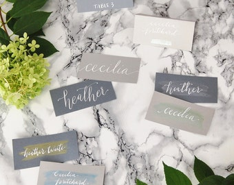 custom calligraphy escort cards   hand lettered   wedding place holders   event name cards