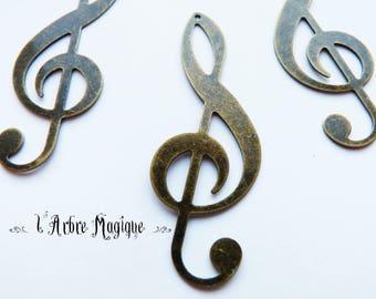 bronze 4 fancy treble clef pendant 19 x 53 mm