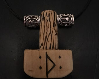 wooden mjollnír with two stainless steel rune beads