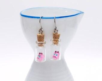 Origami Jigglypuff earrings in tiny glass bottle