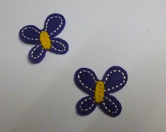 Sewing in yellow and purple butterflies
