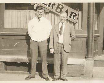 "Vintage Snapshot ""Proud Owners"" Men Standing In Front Of Bar Restaurant Bartender Found Vernacular Photo"