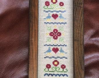 Stitched and Framed Cross Stitch Sampler