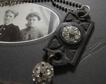 Lovely upcycled keyhole cover necklace with rhinestone embellishments