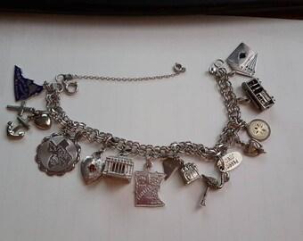Vintage Sterling Silver Unique 12 charm Bracelet!!!