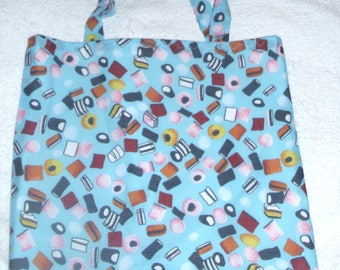 Liquorice Allsorts on blue cloth shopping bag