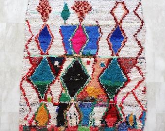 Boucherouite rug , rag of astounding creation .