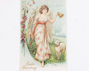 Antique Easter postcard angel ringing a bell with lamb and violets embossed ephemera