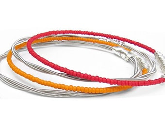 Bracelet Stack // Set of 4 Bangle Bracelets // Guitar String Bracelets / Red, Orange Seed Beaded Bracelets / SIlver Bracelets / Music Sister