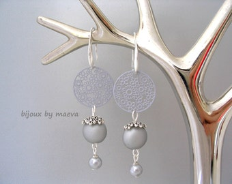 Gray costume jewelry pearl earrings and round metal flower pattern