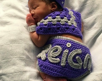 Crochet diaper cover, crown and poncho.