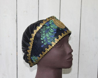 HAT decorated with a central medallion and embroidered with metal washers. It is unique and entirely by hand;