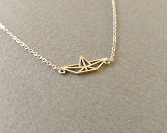 Origami paper boat. Necklace.