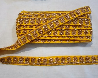 Yellow floral trim with golden rhinestones.