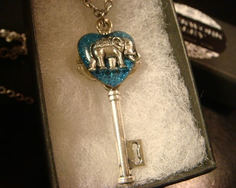 Elephant Heart Key Necklace in Antique Silver- Blue Glitter Background (2097)