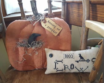 Sitting on a pumpkin - primitive pumpkin with crow in a pocket shelf sitter/door hanger