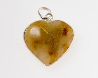 Gold rutile crystal heart pendant