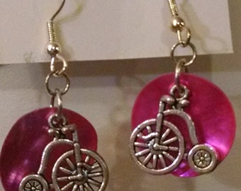 Silver Penny-farthing bicycle and bright fuchsia-pink colored shell disk earrings; feather-light, with ball & coil fishhook findings