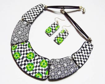 Hinged fancy white, black and green FIMO polymer clay bib necklace