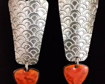 Bold and and really pretty contemporary statement earrings. Argentium silver and red and orange glass enamel.