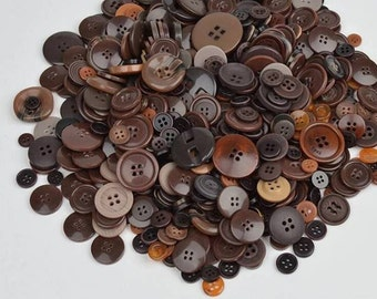 25 buttons in different sizes in shades of brown