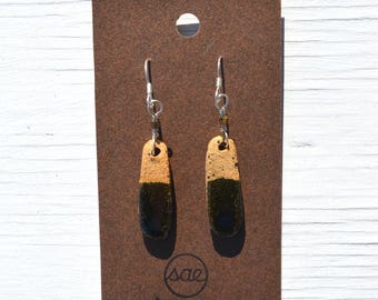 black and raw pill-shaped ceramic earrings