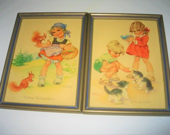 A pair of Lungers Hausen prints of children with animals