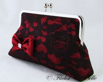 Black lace clutch with red satin inlay and satin red bow and rhinstone