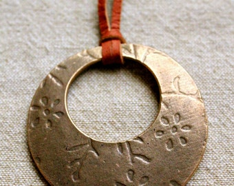Bonze disc pendant with minimalist floral texture, Long statement necklace, gold colored disc with with flower design