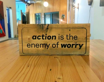 Action is the enemy of worry - reclaimed wood sign