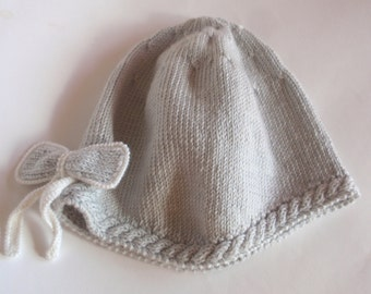 Hand knitted girls grey hat with ribbon