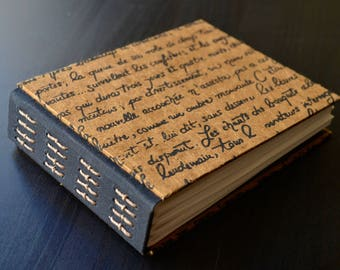 Handmade journal with bow tie stitch and covered in Indian handmade paper