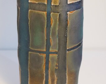 Patterned and textured decorative ceramic art vessel