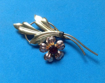 Vintage Van Dell yellow & rose gold fill pin with red rhinestone center