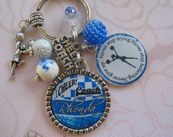 Personalized blue cheer coach keychain, with two different designs