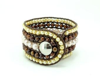 Brown freshwater pearl wrap leather bracelet.