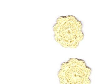 Two crocheted yellow flowers