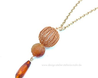 copper wire crochet pendant with carnelian elements