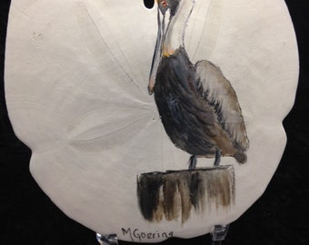 Hand painted Brown Pelican on Sand Dollar