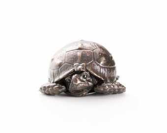 Tortoise hatchling with head tucked in. Open edition bronze.
