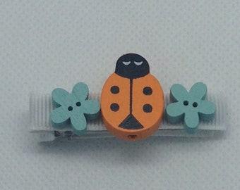Orange and blue ladybug crocodile hair clip
