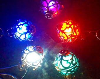 Steampunk Silver Glow in the Dark Filigree Globe Pendant Locket In Your Choice Of 17 Different Color LED or UV Resin Glow Orbs