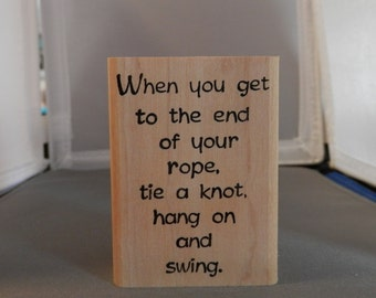 when you get to the end or your rope, tie a knot, hang on and swing.
