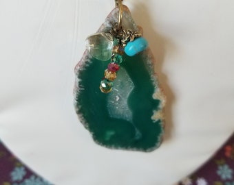 Green translucent pendant with small accents
