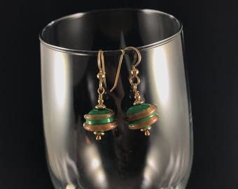 Green and gold swirl earrings! Set on gold filled findings. Add some bling to your everyday.  Perfect for a splash of color.